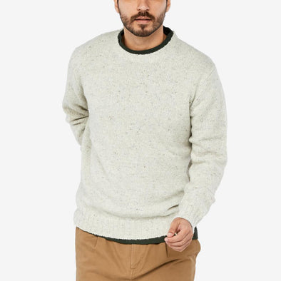 Knit in a mix of durable wool blends finished with hammer sleeves and ribbed finish on collar cuffs and hem.