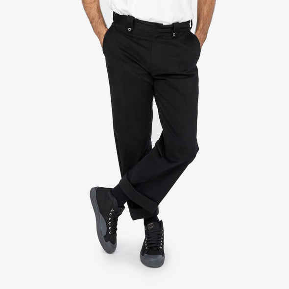 Black cotton trousers with side pockets.