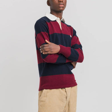 Knitted striped in navy and bordeaux polo features a clean neck with fine seams and a duck patch on the left chest.