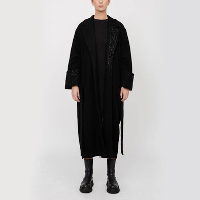 Oversized overcoat with embroidery cuffs and collar.