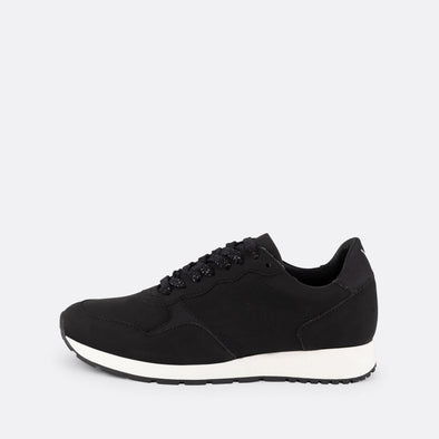 Minimalistic black runners with white sole and brand logo on the ankle.