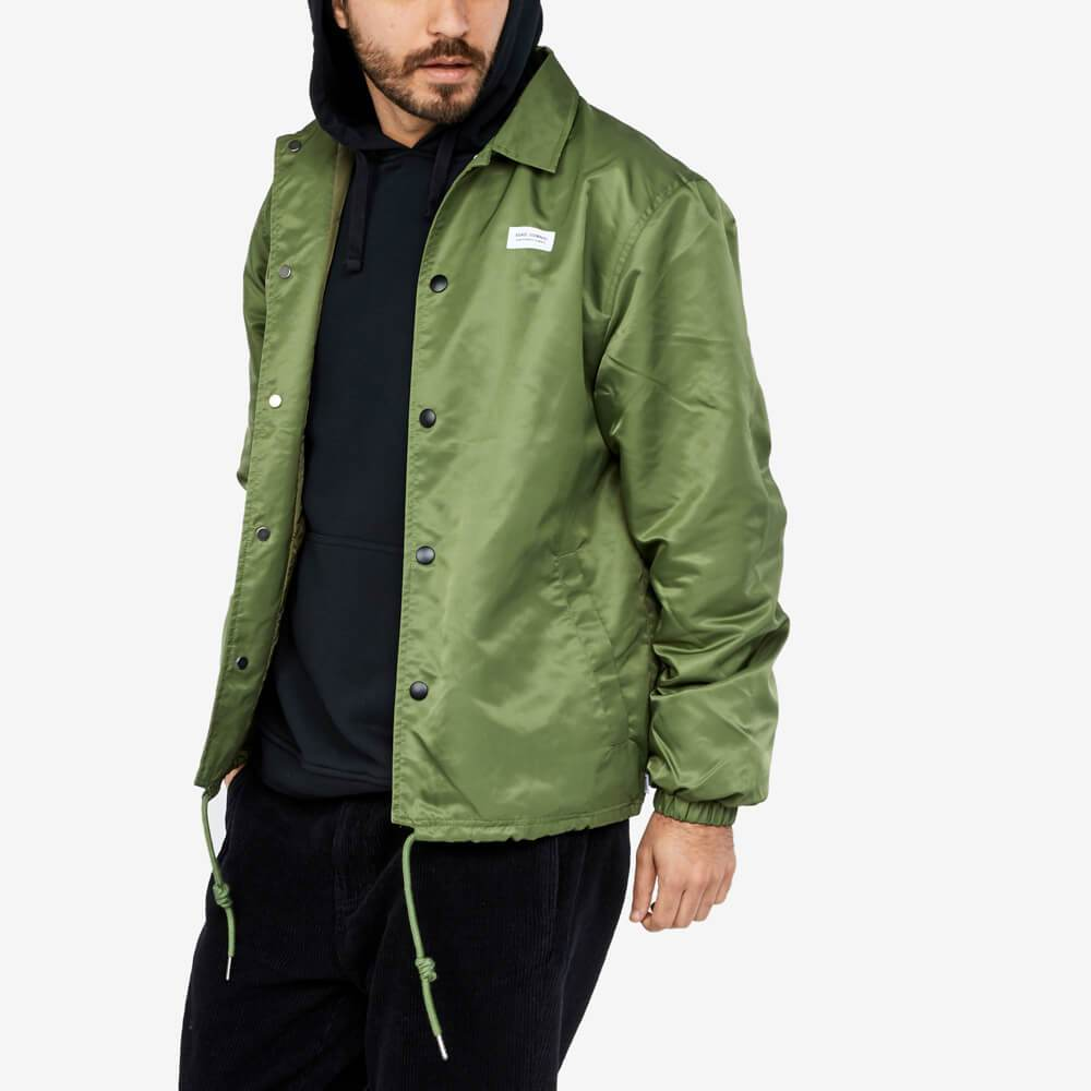 Snap button closure jacket with welt pockets and drawstring hem.