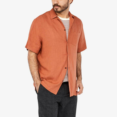 Shirt with camp collar and chest pocket.