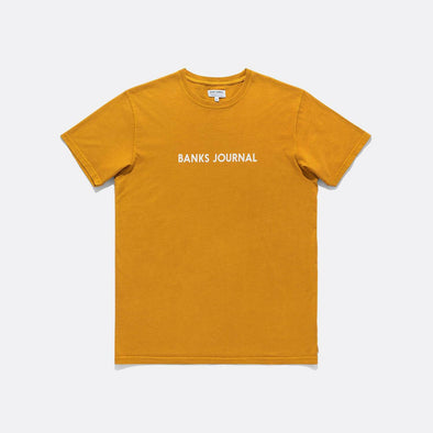 Yellow t-shirt, fabric dyed, and label front logo print.