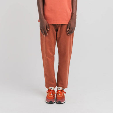 Loose fit coral trousers with elastic waistband with drawstring for ease.