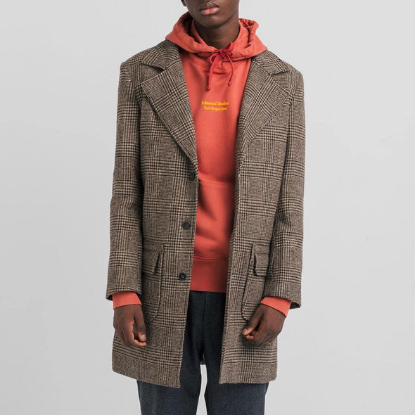 Long overcoat in 100% brown wool featuring two square pockets and button closure.
