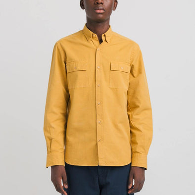 Classic fit yellow shirt finished with buttons and a round chest pocket.