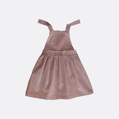 Pinafore dress in purple corduroy.