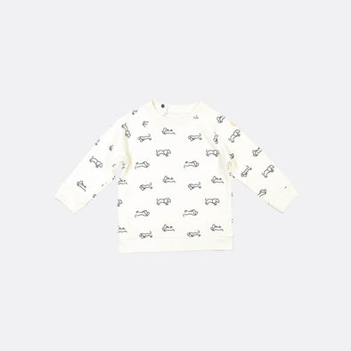 White longsleeve sweatshirt with running around dogs all over print and shoulder opening with snap fasteners.