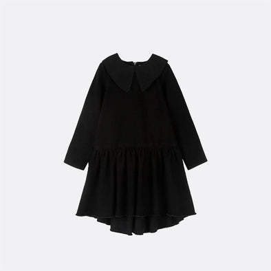 Knee-high black denim dress with peter pan collar.