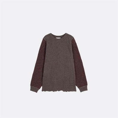 Multi-stitch contrast knitted jumper.