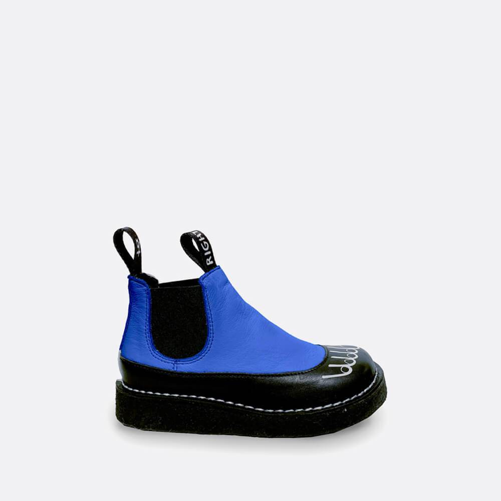Chelsea boots in black and blue leather with feet print in white.