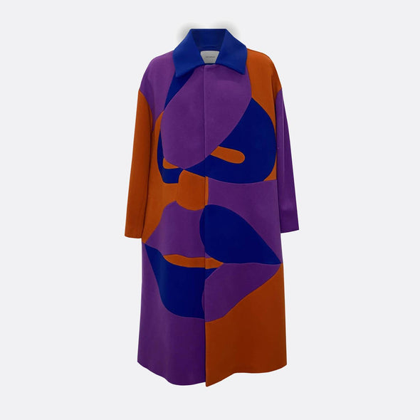 Unisex oversize overcoat in purple, blue and brown all over face profile pattern.