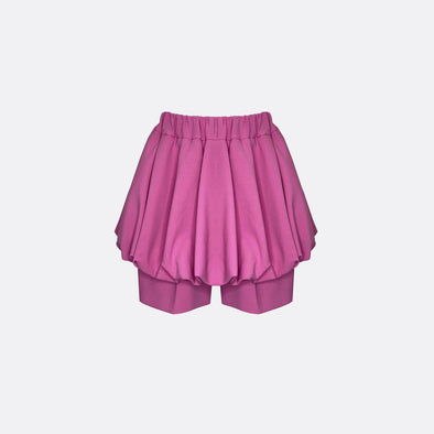 Regular fit pink shorts with balloon skirt overlay.