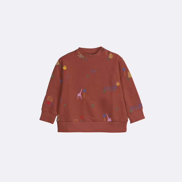 Round neck long sleeve basic red sweatshirt with garment dye and all over print.