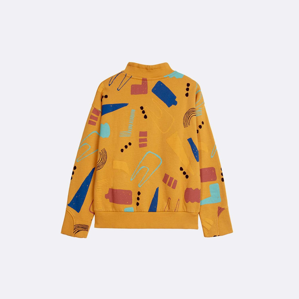 Printed half neck yellow sweater with all over plasticarium print.