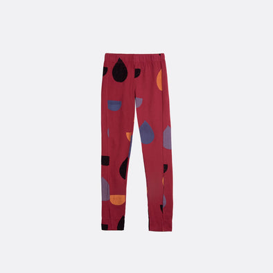 Elastic waistband red leggings with garment dye and all over print.