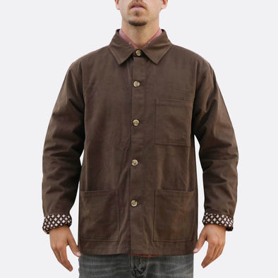Brown shirt jacket with button fastening and two front hand pockets and one chest pocket.