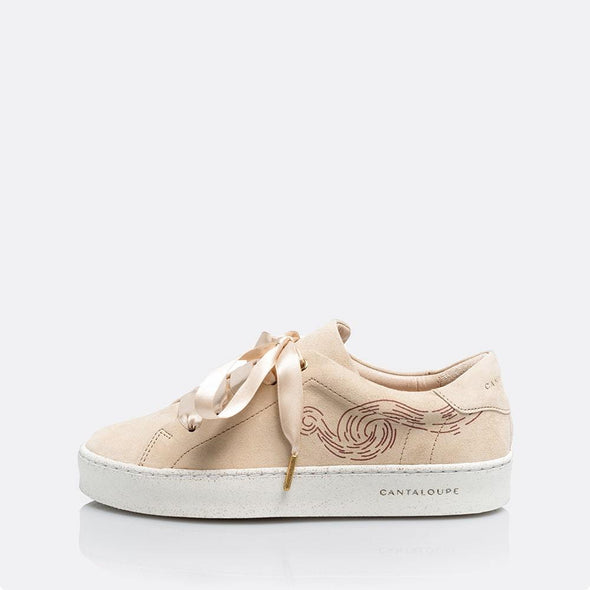 Low top beige sneakers in natural suede with print detail.