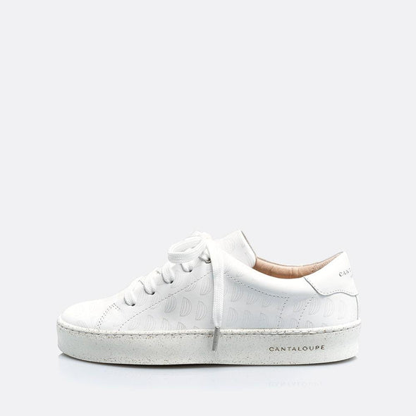 Low top white sneakers in leather and suede with detail cantaloupe print.