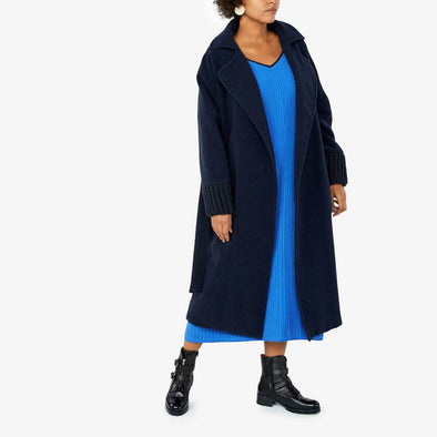 Navy blue relaxed fit coat with dropped shoulders and wide sleeves.