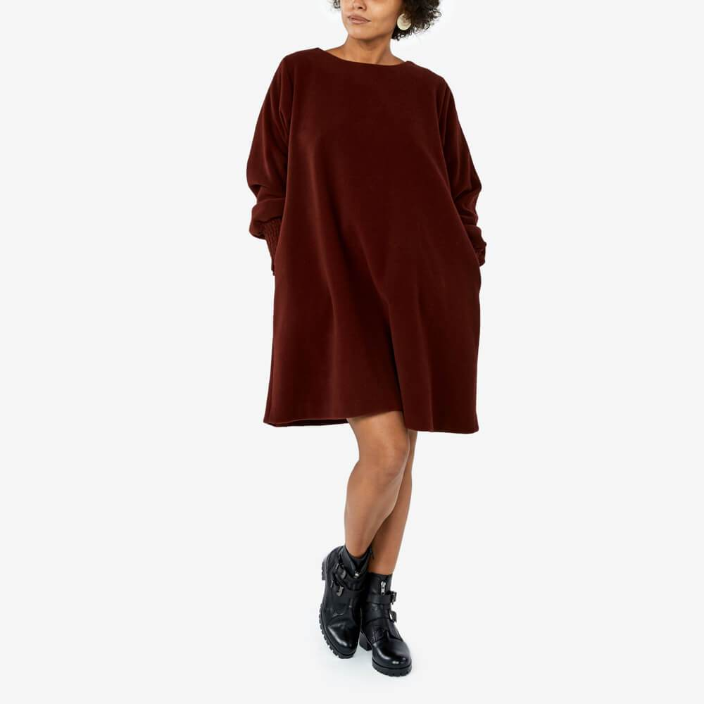 Bordeaux oversized wool dress with a round neckline and long cuffed sleeves.