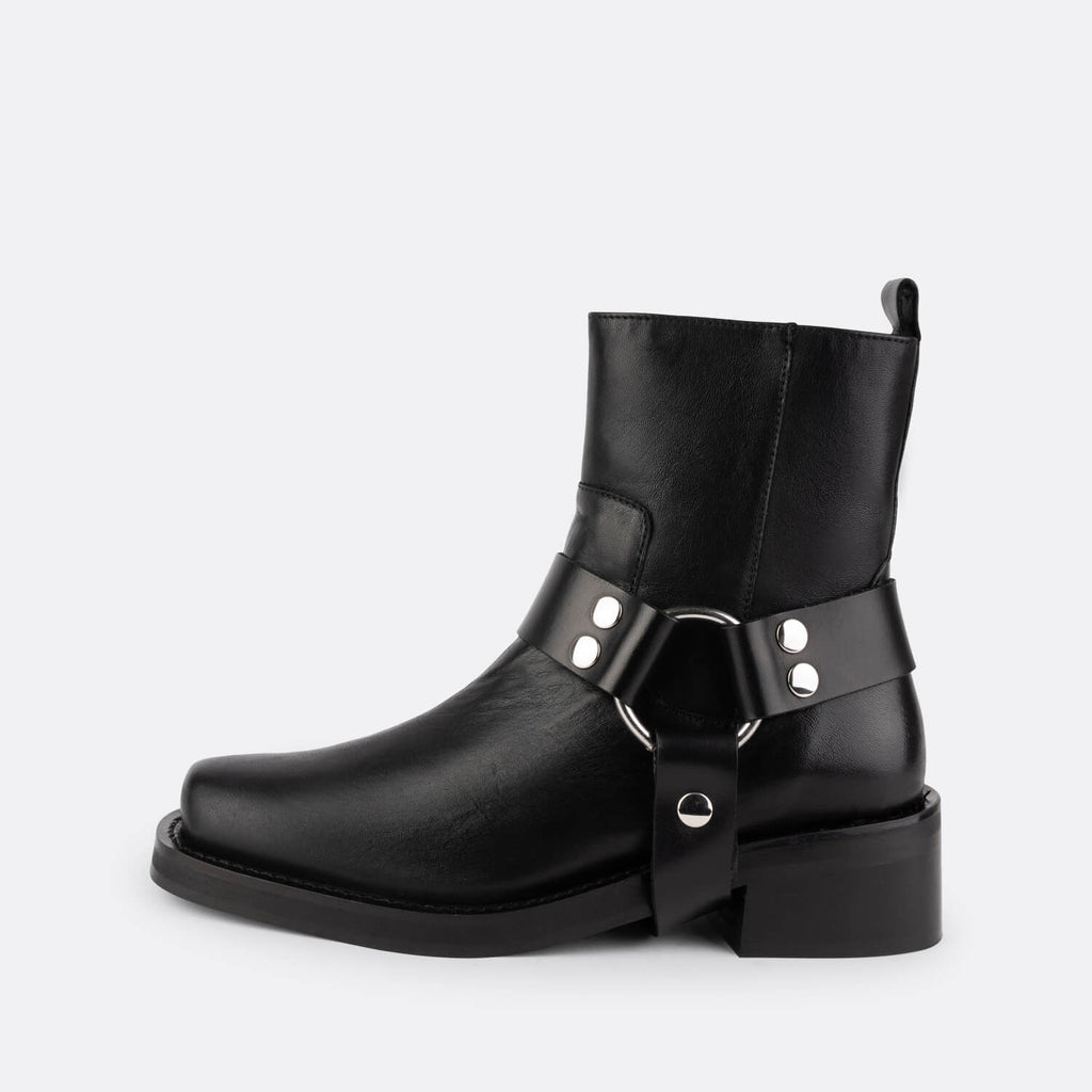 Biker boots in soft black bovine leather with removable harness.