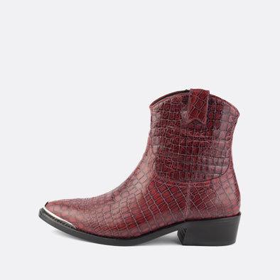 Western boots in dark red leather with crocodile print and silver metal toe piece featuring side zipe.