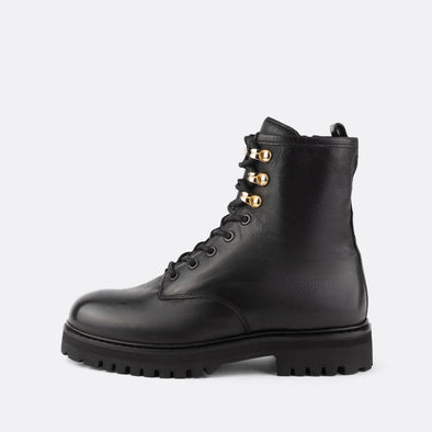 Combat lace-up boots in 100% black leather.