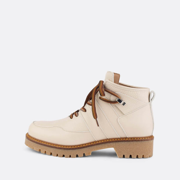 Beige laced-up ankle boots with rubber chunky soles.