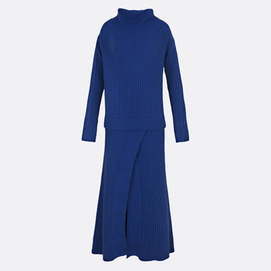 Knitted longsleeve blue dress in 100% wool featuring opening on the skirt and overlayered top.