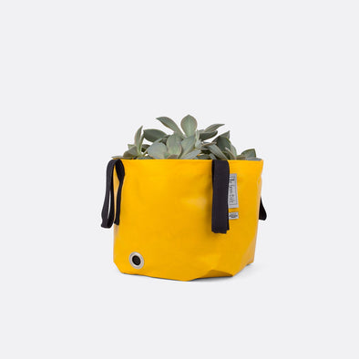 Yellow resistand and durable bag to organize outdoor gardens with a pop of color.