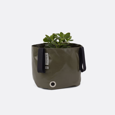 Green resistand and durable bag to organize outdoor gardens with a pop of color.