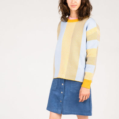 Wide cut sweater with blue and ochre stripes.