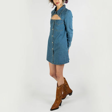 A denim dress/jacket duo featuring an intricate jewel trim.