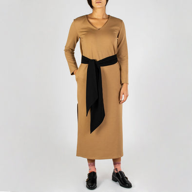 Beige comfortable long dress with side bands, V neckline and long sleeves.