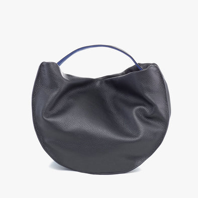 Circular handbag in black full grain leather with thin strap with inside in deep blue