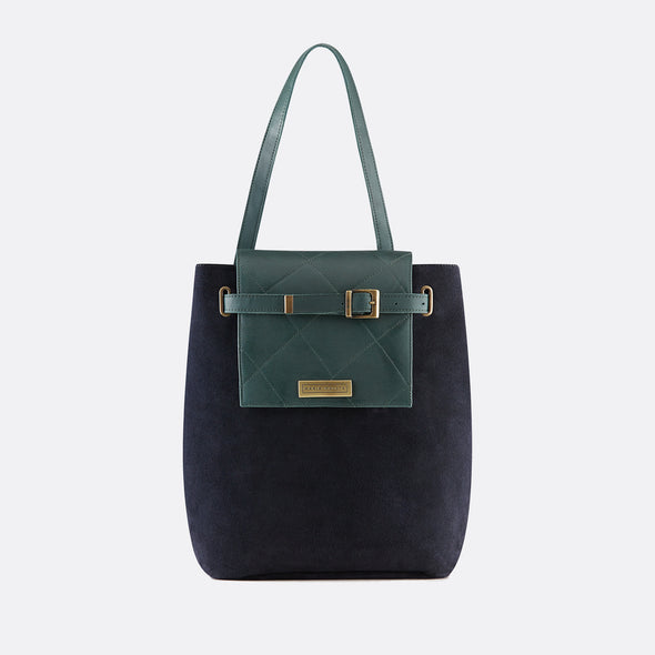 Faceted reversible bucket-style retro bag in deep green leather and navy blue nubuck  with adjustable strap.