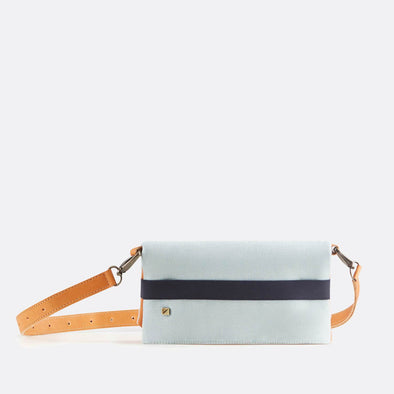 Reversible belt-bag in recycled light blue cotton and camel premium sustainable tanned leather.