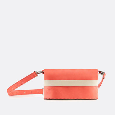 Reversible belt-bag in recycled light pink cotton and coral premium sustainable tanned leather.