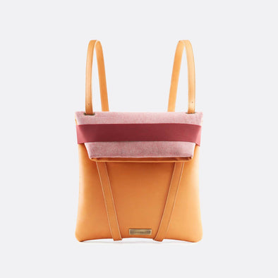 Reversible backpack in light pink cotton and camel leather with fold-top and bordeaux elastic.