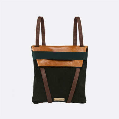 Faceted reversible backpack in dark green and camel leather with fold-top and elastic.