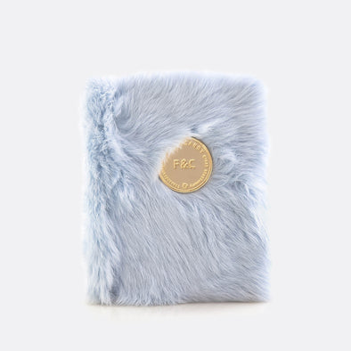 A6 notebook with 160 plain pages and light blue furry leather cover.