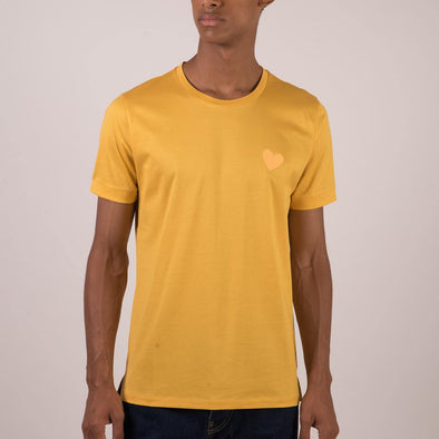 Yellow t-shirt with heart embroidery on the chest.