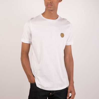 White t-shirt with lion head embroidery patch on chest.