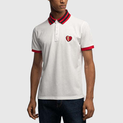 White classic polo with embroidery heart on chest and striped collar featuring hem detail on sleeves.