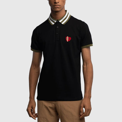 Black classic polo with embroidery heart on chest and striped collar featuring hem detail on sleeves.