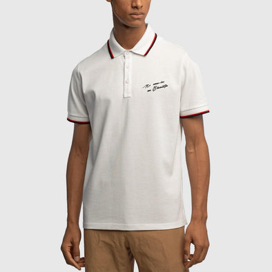 White classic polo with front print on chest featuring collar and hem detail on sleeves.