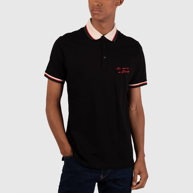 Black classic polo with front print on chest featuring collar and hem detail on sleeves.