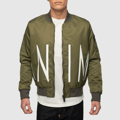 Green bomber with oversize inimigo print from the front to the back.